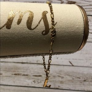 "18 karate gold filled bracelet with ""L"" charm"
